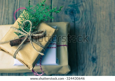 Christmas presents in rustic style with holiday decorations, selective focus - stock photo
