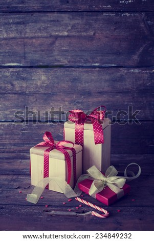 Christmas presents on dark wooden background in vintage style  - stock photo