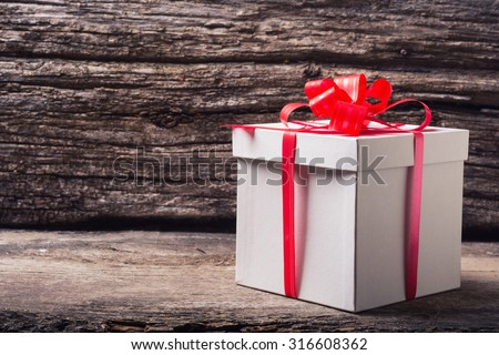 Christmas presents with gift box on wooden background . - stock photo