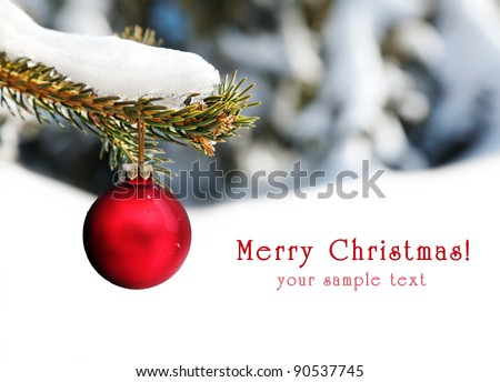 Christmas red ball hanging on the branch at snow tree background with free space for your text - stock photo