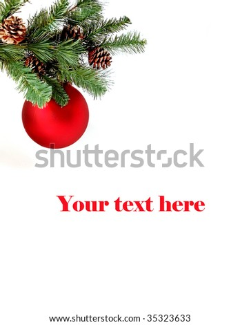 Christmas red ball on pine tree decoration with space for text, vertical - stock photo
