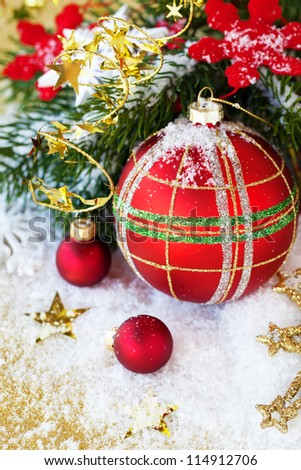 Christmas red balls with snow and branch of pine - stock photo