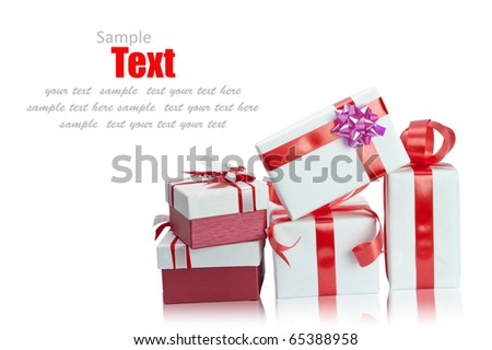 Christmas red gift box tied with gold ribbon bow on white background