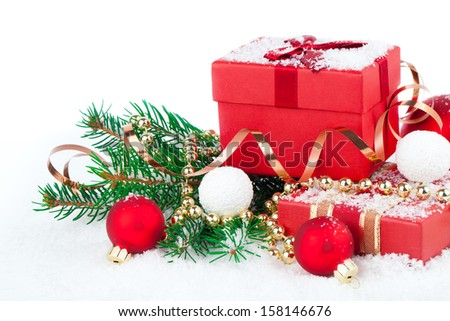 christmas red gift with festive decorations on snow background - stock photo