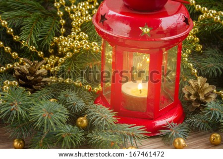 christmas red glowing  lantern close up  with evergreen tree