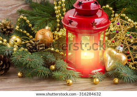 christmas red glowing lantern with evergreen tree