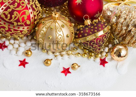 christmas red heart and golden ball with evegreen tree  in snow