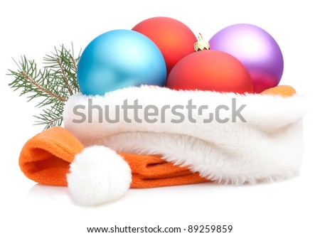 Christmas Red, Purple, Blue Baubles in Traditional Santa Hat and branch of tree Isolated on white background