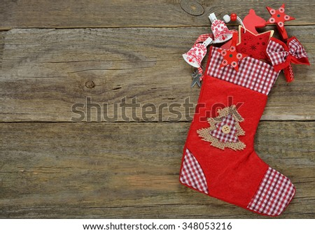 Christmas red stocking on a wooden background - stock photo