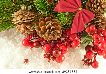 Christmas red tape and branch of berries and fur-tree - stock photo