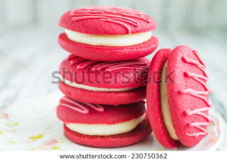 Christmas red velvet macaroon on wooden background - stock photo