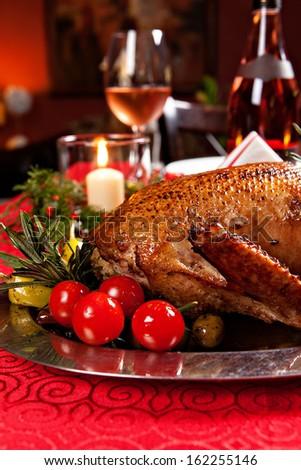 Christmas roast duck served on a festive table - stock photo