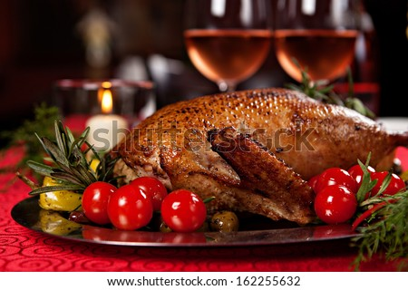 Christmas roast duck served on a festive table - stock photo