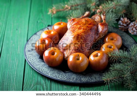 Christmas roast duck with baked apples, selective focus - stock photo