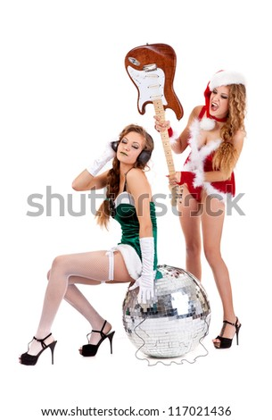 Christmas rock band with sexy girls isolated on a white background - stock photo