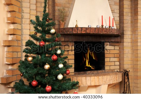 Christmas room with fireplace and decorated fir tree with toys on it