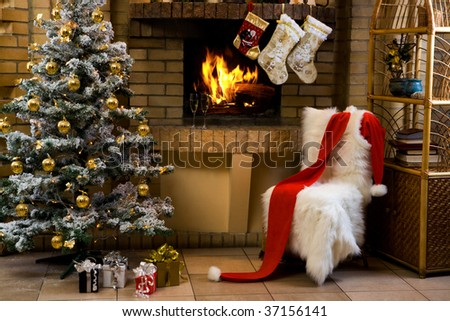 Christmas room with fireplace, chair, presents under decorated fir tree and toys in it - stock photo