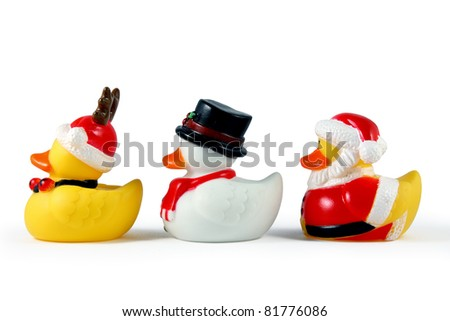 Christmas rubber duckies on white. - stock photo