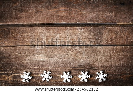 Christmas rustic background with white snowflakes and free text space. Festive vintage planked wood with copyspace  - stock photo
