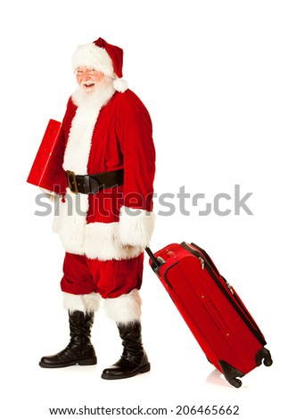 Christmas: Santa Claus Ready For Vacation With Suitcases and Gifts - stock photo