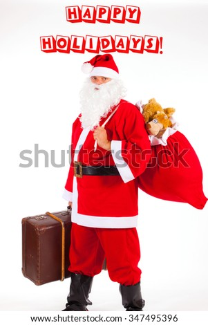 Christmas Santa Claus with a big brown suitcase