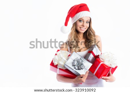 Christmas Santa hat isolated woman portrait hold christmas gift.  - stock photo