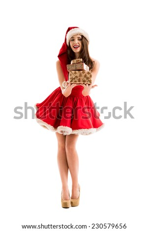 Christmas Santa hat isolated woman portrait sharing Christmas gifts. Smiling happy girl on white background.