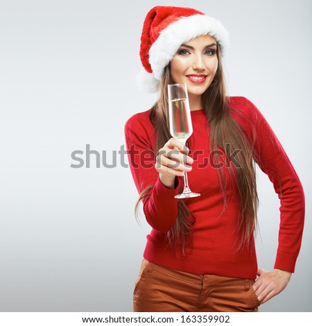 Christmas Santa woman isolated portrait. Beautiful model portrait isolated over studio background hold wine glass. - stock photo
