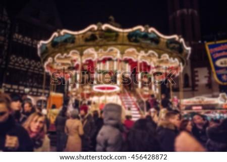 Christmas scene: Night view of carousel - stock photo