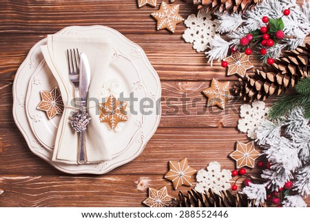 Christmas serving table in shabby chic style. Gingerberad decorations - stock photo