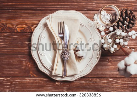 Christmas serving table in shabby chic style. Top view, crochet snowflakes - stock photo