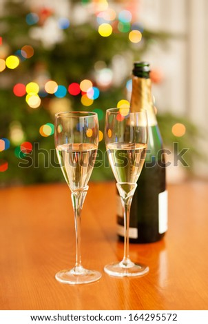 Christmas setting with champagne and Christmas tree - stock photo