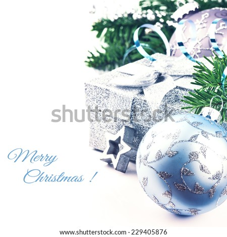 Christmas setting with present and festive ornaments isolated over white - stock photo