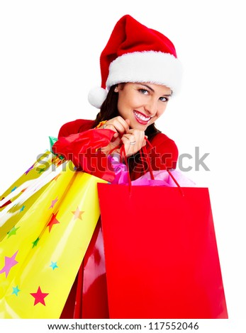 Christmas Shopping santa woman with a bags isolated on white background. - stock photo