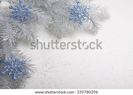 Christmas silver twig with blue snowflakes.  - stock photo