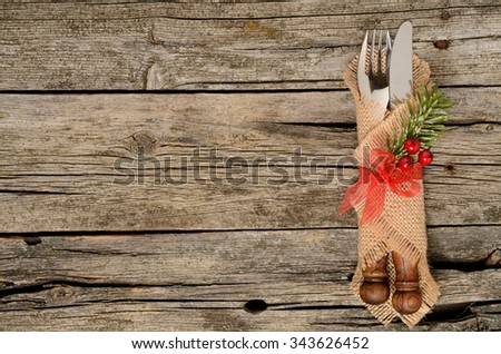 Christmas silverware at wooden table. Top view, copy space. - stock photo