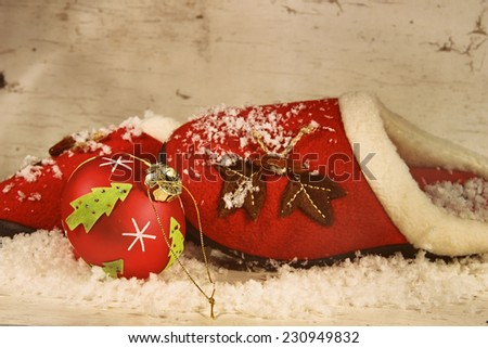 Christmas slippers with ornament and snow - stock photo