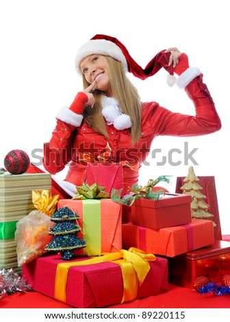 Christmas smiling woman in red santa cap with a gift. isolated on a white background