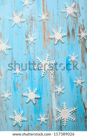 Christmas snowflakes on a wooden background - stock photo
