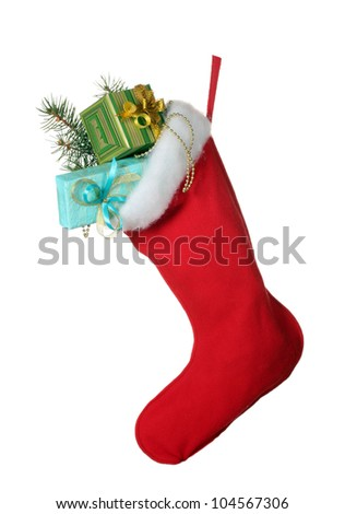 Christmas sock with gifts isolated on white - stock photo