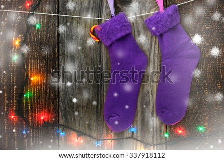Christmas socks on the clothespins with candy - stock photo