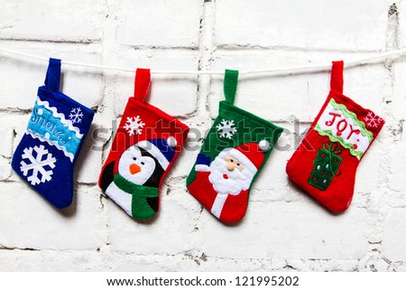 Christmas socks on the white wall - stock photo
