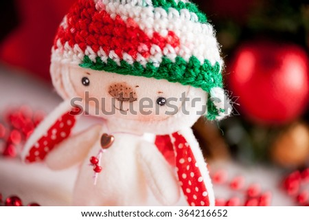 Christmas soft toy bunny in the cap - stock photo