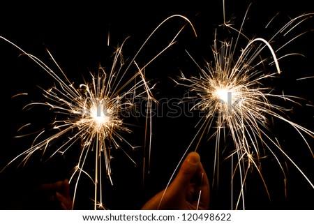christmas sparkler firework flame on black - stock photo