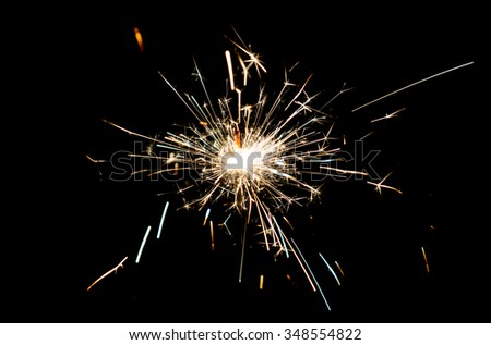 Christmas sparkler isolated on black - stock photo