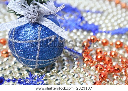 Christmas sphere of dark blue color with a pattern on a background of a multi-coloured beads - stock photo