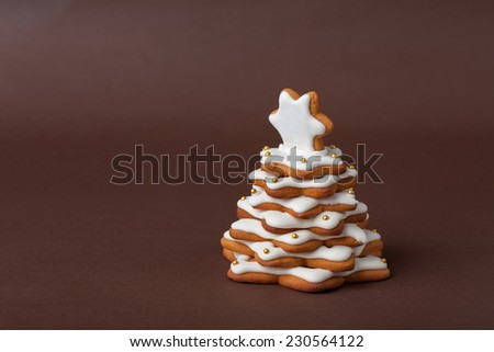 christmas spice cake in the form of fir on the brown background - stock photo