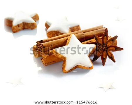 Christmas spices and stars still life with delicious star-shaped cookies, cinnamon sticks and star anise on a white background - stock photo