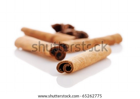 christmas spices: anise, cinnamon and cloves isolated on white