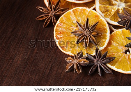 Christmas spices. Anise stars and sliced of dried orange - stock photo